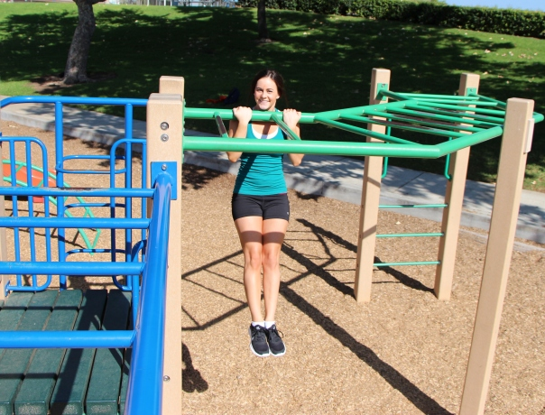 LA Fitness Member Haley doing pull ups on the monkee bars at the park