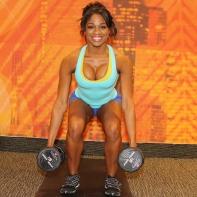 Denita doing dumb bell squats at LA Fitness