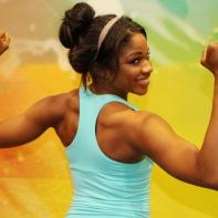 Denita flexing her back at LA Fitness