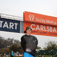 LA Fitness member Joey tries to keep dry as she prepares for the Carlsbad Half Marathon