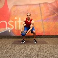 Medicine ball opposite shoulder raise from squat -1