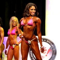 Denita Poses on stage as she competes in the Amateur Bikini eventat the Arnold Sports Festival 2013