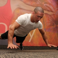 LA Fitness Member Bryant Performing Explosive X Push-Ups (Step 3)