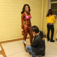 Denita behind the scenes before the show getting glazed and spray tanned