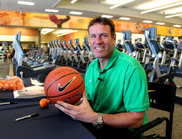 Phoenix Suns legend Dan Majerle autographs a basketball for the LIVING HEALTHY give away contest