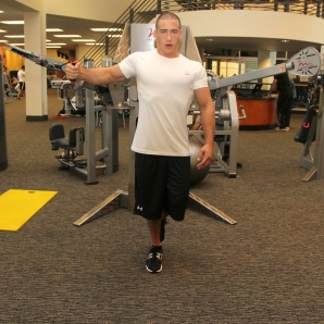 LA Fitness Member Bryant Performing Single Leg, Single Arm Cable Fly (Step 1)