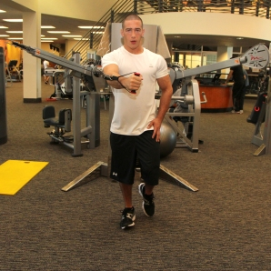LA Fitness Member Bryant Performing Single Leg, Single Arm Cable Fly (Step 2)