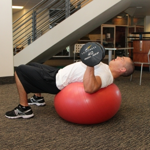 LA Fitness Member Bryant Performing Stability Ball Dumbbell Chest Press (Step 1)