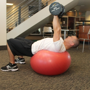 LA Fitness Member Bryant Performing Stability Ball Dumbbell Chest Press (Step 2)