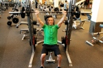 Bryant doing a shoulder press at LA Fitness on the Smith machine-2