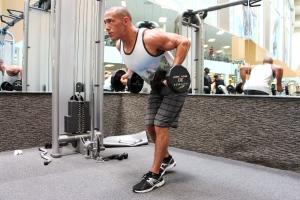 LA Fitness Member Bryant doing a dumbbell row