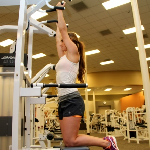 Bailey doing a pull up at la fitness - 1