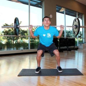 Basil doing a squat at LA Fitness