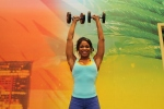 Denita doing dumbbell shoulder press at LA Fitness