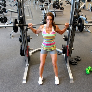 Laura does a smith machine squat at LA Fitness