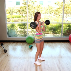 Laura doing barbell bicep curls at LA Fitness -4