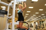 Toni doing a chin up at la fitness - 2