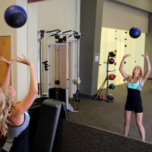 Toni doing a medicine ball shoulder toss at la fitness - 2