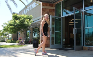 Chrissy in stops to show her scarred knee post surgery at LA Fitness