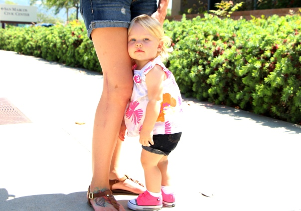 Chrissy's daughter Camryn rests against her mom's Surgically repaired knee outside of LA Fitness