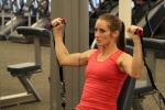 Bethany doing cable shoulder press at LA Fitness 1