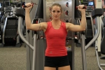 Bethany doing standing cable shoulder presses at LA Fitness 1