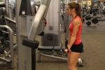 Bethany doing standing cable triceps pushdown option 2 at LA Fitness 2