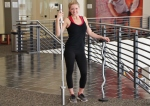 Alyssa at LA Fitness with curl bar and straight bar