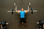 Bryant does a bench press at LA Fitness - 2