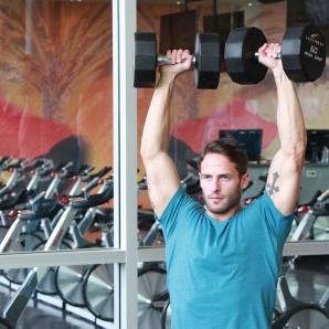 James-performing-shoulder-press-drop-set-at-LA-Fitness
