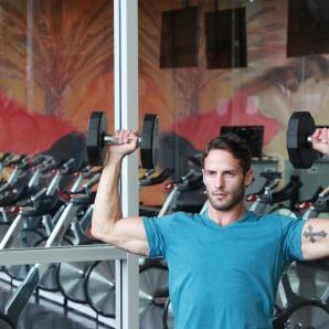 James-performing-shoulder-press-drop-set-at-LA-Fitness-3
