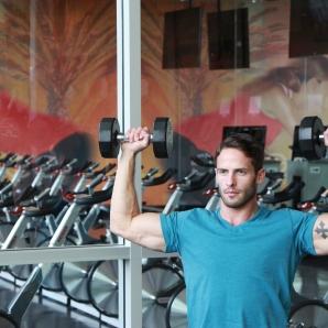 James-performing-shoulder-press-drop-set-at-LA-Fitness-5