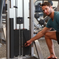 James-adjusting-weight-before-performing-chest-fly-drop-set-at-LA-Fitness
