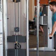 James-performing-tricep-push-down-drop-set-at-LA-Fitness-4