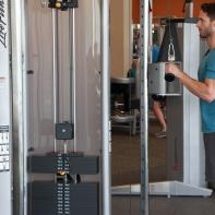 James-performing-tricep-push-down-drop-set-at-LA-Fitness-3