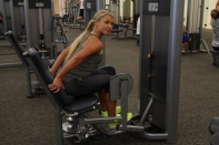 Abductor machine prop up and lean forward progression exercise (1)