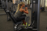 Abductor machine prop up and lean forward progression exercise (2)