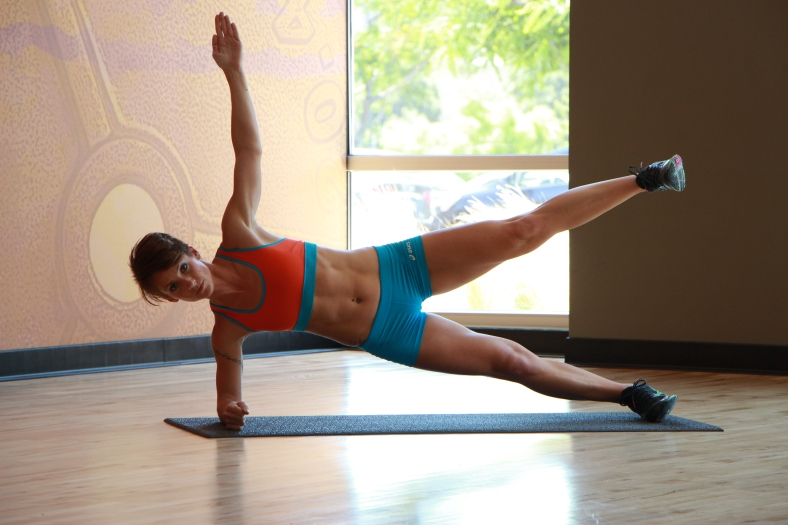 Bethany performing side plank with leg raised