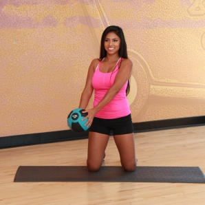 Cynthia-performing-kneeling-wood-chop-with-medicine-ball-LA-Fitness-2