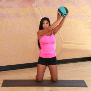 Cynthia-performing-kneeling-wood-chop-with-medicine-ball-LA-Fitness