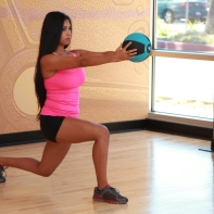 Cynthia-Performing-Lunge-with-arm-extension-and-medicine-ball-at-LA-Fitness-2