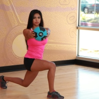 Cynthia-Performing-Lunge-with-arm-extension-and-medicine-ball-at-LA-Fitness-3