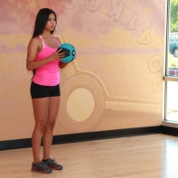 Cynthia-Performing-Lunge-with-arm-extension-and-medicine-ballat-LA-Fitness