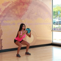Cynthia-performing-medicine-ball-squat-to-throw-at-LA-Fitness-2