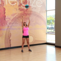 Cynthia-performing-medicine-ball-squat-to-throw-at-LA-Fitness-4