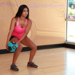 Cynthia-performing-medicine-ball-wood-chop-with-squat-at-LA-Fitness-2