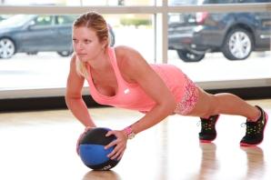 Danica performing medicine ball push-ups at LA Fitness - 2
