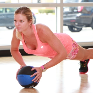 Danica performing medicine ball push-ups at LA Fitness - 2
