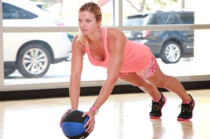 Danica performing medicine ball push-ups at LA Fitness