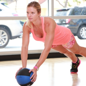 Danica performing medicine ball push-ups at LA Fitness